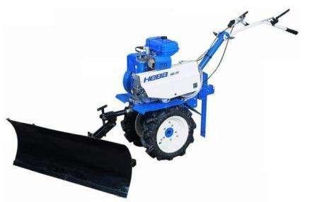 Снігоочисні насадки на міні-трактор: різновиди та їх використання